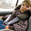 Stock Photo: Baby in child seat in car