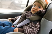 Baby in child seat in the car — Stock Photo