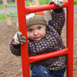 Little boy climbs ladder on playground in courtyard — Stock Photo