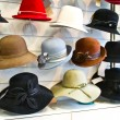 Stock Photo: Women felt hats in the shop