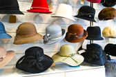 Women felt hats in the shop — Stock Photo