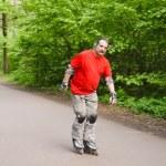 Elderly man rides a roller — Stock Photo