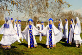 Russian girls in sundresses round dance of birches — Stock Photo