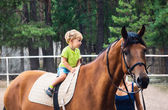 Two year boy drive astride horse — Stock Photo