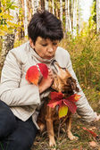 Walk with dog in autumn wood — Stock Photo