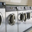 Laundromat front loading washers — Stock Photo #12097401