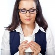 Businesswoman holding cup of drink — Stock Photo