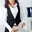 Businesswoman standing behind the desk - Stock Photo