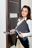 Businesswoman standing near the door — Stock Photo
