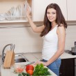 Happy smiling woman taking plate — Stock Photo