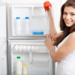 Woman searching in her fridge — Stock Photo #13183290