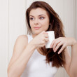 Stock Photo: Beautiful woman enjoying tea and cookies