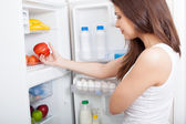 Woman searching in her fridge — Stock Photo