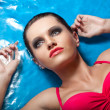 Woman with smoky eyes laying in water — Stock Photo #13750898