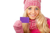 Blonde woman holding blank card — Stock Photo
