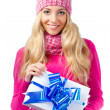 Woman wearing knitwear holding giftbox — Stock Photo