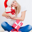 Blonde woman holding gift box — Stock Photo