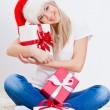 Blonde woman holding gift box — Stock Photo #14567217