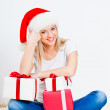 Blonde woman holding gift box — Stock Photo #14567707