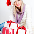 Woman wearing santa hat sitting on the floor — Стоковая фотография