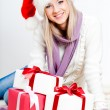 Woman wearing santa hat sitting on the floor — ストック写真