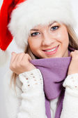 Closeup portrait of woman in santa hat — Stock Photo