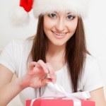Brunette woman wearing santa hat — Stock Photo #15572657