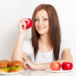 Woman sitting behind the table with food — Stock Photo