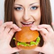 Woman going to eat hamburger — Stock Photo