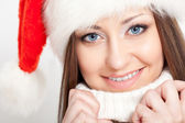 Smiling brunette woman in santa hat — Stock Photo