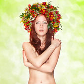 Red haired woman with flower wreath — Stock Photo