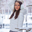 Brunette woman standing in winter park — Stock Photo