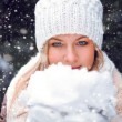 Woman holding snow on hands — Stock Photo