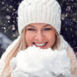 Happy woman holding snow — Stock Photo #18912253