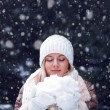 Happy woman with closed eyes holding snow — Stock Photo