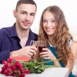 Young couple  drinking red wine — Stockfoto