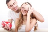Man giving heart-shaped box for his girlfriend — Stock Photo
