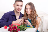 Young couple drinking red wine — Stock Photo
