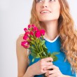 Woman holding bouquet of roses — Stock Photo #20097529