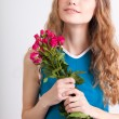 Woman holding bouquet of roses — Stock Photo