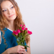 Woman holding bouquet of roses — Stock Photo #20097585