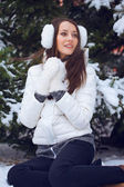 Woman sitting in winter park — Stock Photo