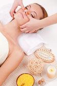 Woman receiving face massage — Stock Photo