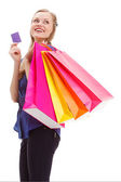 Woman holding shopping bags and card — 图库照片