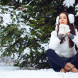 Woman sitting in winter park — Stock Photo #21560543