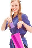 Donna bionda mettere in carta in sacchetto — Foto Stock