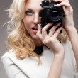 Blonde girl with  retro camera - Stockfoto