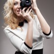 Blonde girl with retro camera — Stock Photo #22997244