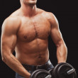 Man excersizing with dumbbells — Stock Photo