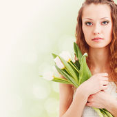 Woman holding tulips — Stock Photo